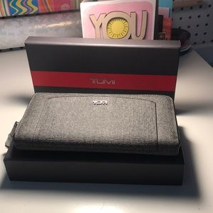 Brand new with tags TUMI Zip Sinclair Wallet
